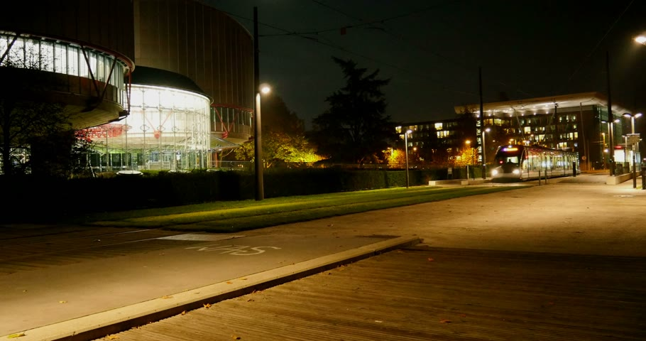 coe : STRASBOURG, FRANCE - NOVEMBER 6, 2014:  Headquarters of European Court of Human Rights - ECHR - with a tramway passing in front of the building at night.  ECHR is a international court established by the European Convention on Human Rights.