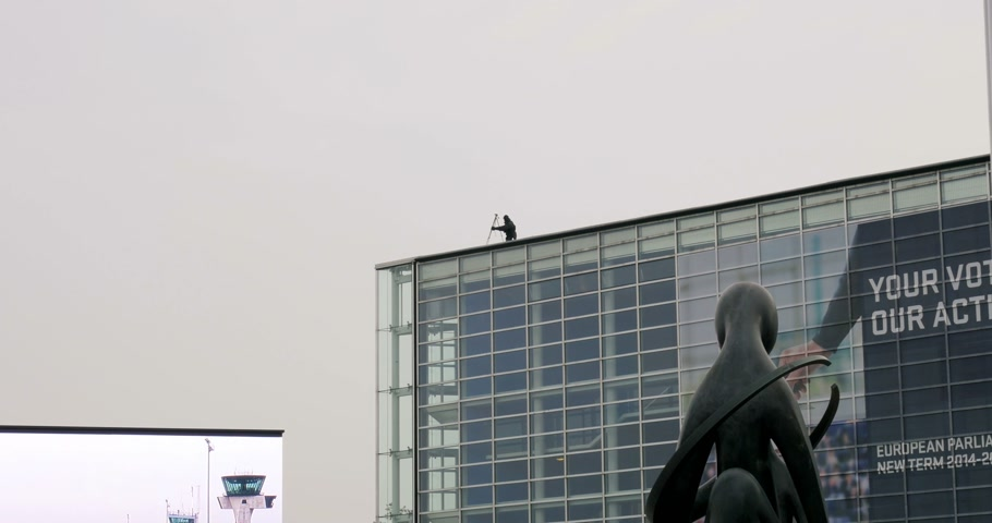 sniper scope : STRASBOURG, FRANCE - 25 NOVEMBER 2014: Solider in camouflage on the roof of European Parliament roof in Strasbourg, France during first Pope Francis visit to France. 4K Production Digital Camera used - easy to crop and edit