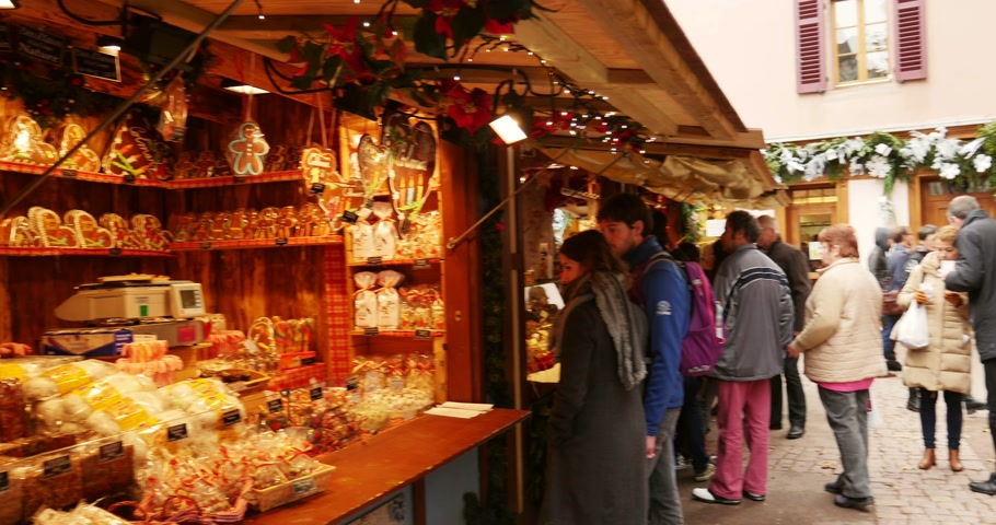faház : COLMAR, FRANCE - DEC 18, 2014: People doing Christmas shopping at traditional market chalet of new year and Christmas sweet bakery products. Shot on UHD 4K Production Digital Camera - easy to crop and edit