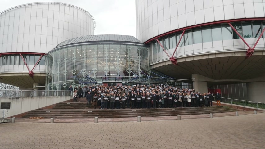 european court of human rights : STRASBOURG, FRANCE - 8 JAN 2015: European Court of Human Rights President, Judges and jurists observe a minute of silence in Strasbourg for the victims of an attack by armed gunmen on the offices of French satirical newspaper Charlie Hebdo in Paris on Jan