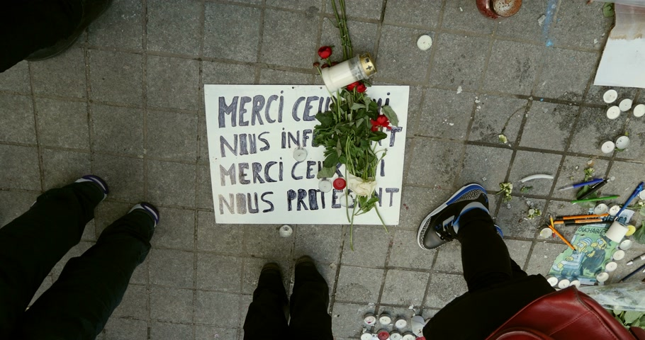 mourners : STRASBOURG, FRANCE - 11 JAN, 2015:  Candles, pencils, flowers and placards reading Thank You Charlie during a unity rally (Marche Republicaine) where some 50000 people took part in tribute three-day killing spree in Paris