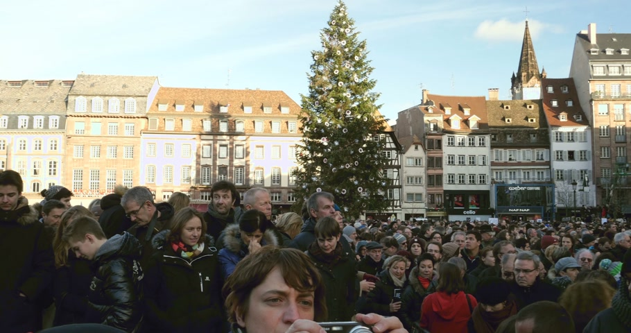 je suis charlie : STRASBOURG, FRANCE - 11 JAN, 2015:     Place Kleber during a unity rally (Marche Republicaine) where some 50000 people took part in tribute three-day killing spree in Paris