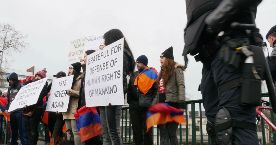 genocide : STRASBOURG, FRANCE - 28 JAN 2015 Armenian diaspora demonstrates near European Court of HR before the Perincek vs. Switzerland case begin. Armenian government was represented by Amal Clooney Stock Footage