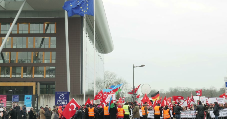 genocide : STRASBOURG, FRANCE - 28 JAN 2015 Turkey diaspora demonstrates near European Court of HR before the Perincek vs. Switzerland case begin. Armenian government was represented by Amal Clooney