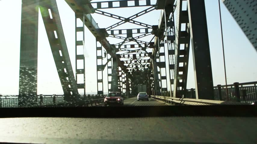 bridge man made structure : BULGARIA - CIRCA AUGUST 2014; POV of car driving on Giurgiu-Rousse friendship bridge - The Danube Bridge (formerly known as the Friendship Bridge). Bridge opened on 20 June 1954