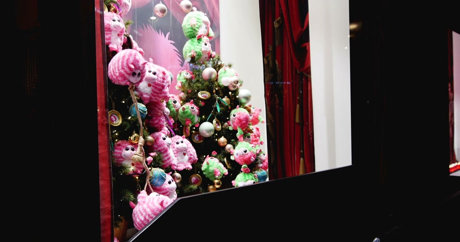 lafayette : STRASBOURG, FRANCE - CIRCA DEC 2014: Kids admiring magic window shopping at Galeries Lafayette store decorated with traditional Christmas themes toys. The iconic store in Strasbourg continues to carry on the holiday tradition for the magic  time of Christ