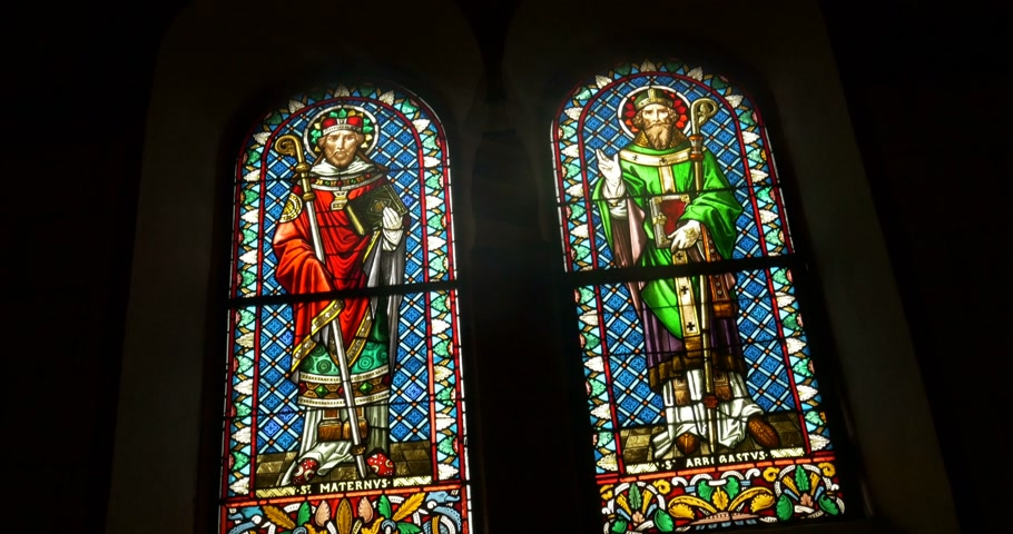 pinturas : EGUISHEIM FRANCE  CIRCA 2015:  Stained glass of Saint Maternis and Saint Abrogate at Leo chapel where relics of Pope St Leo IX are conserved
