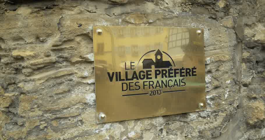 admirado : EGUISHEIM FRANCE  CIRCA 2015: Le village prefer des Francais  the most admired village of French people golden plaque as seen in Eguisheim Alsace winner of 2013 edition.