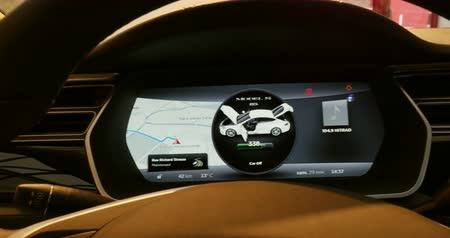 tesla model s : PARIS, FRANCE - CIRCA 2015: Tesla Hybrid car dashboard in action. Tesla is an American company that designs, manufactures, and sells electric cars