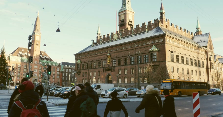 kodaň : COPENHAGEN DENMARK  CIRCA 2015: People passing the street in front of Copenhagen City Hall Kobenhavns Radhus the seat of the Mayor and municipal council