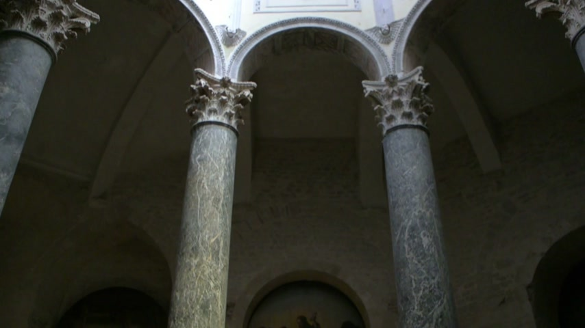 baptismal : Ray of light inside the Baptistery of Aix Cathedral 6h century with tilt-up to the cathedral dome. The columns are probably from a Roman temple that stood on the same site Stock Footage