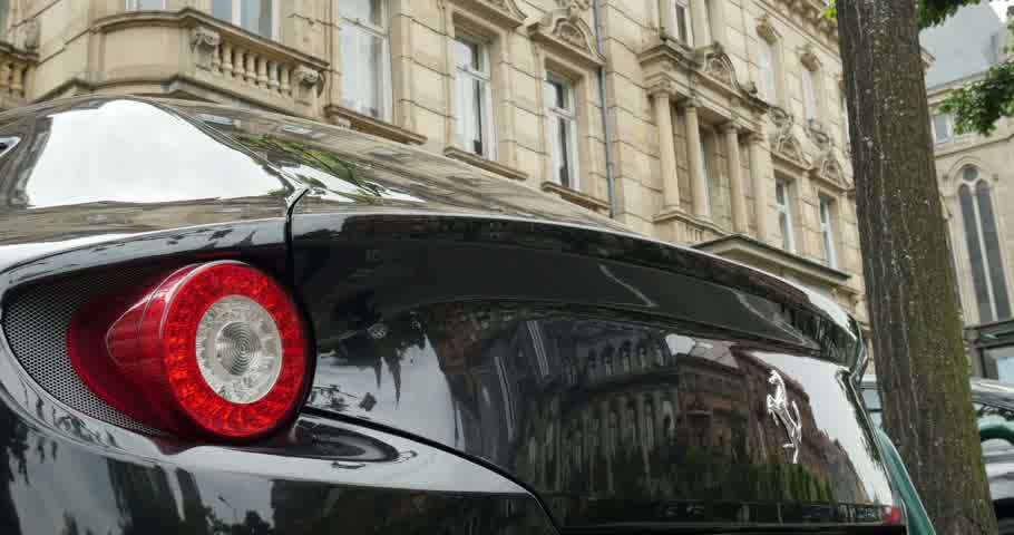 pininfarina : PARIS, FRANCE - CIRCA 2015: Tilt down to Ferrari logotype on the rear side of a Ferrari FF model. The Ferrari FF - Ferrari Four is a four seats and four-wheel drive grand tourer and is the fastest four-seat automobile