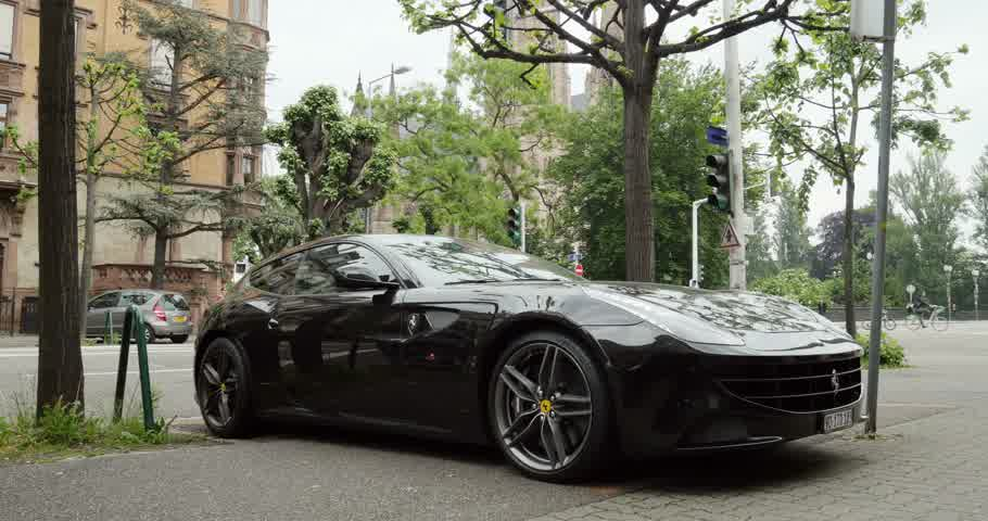 pininfarina : PARIS, FRANCE - CIRCA 2015: Beautiful Ferrari FF model. Parked in city. The Ferrari FF - Ferrari Four is a four seats and four-wheel drive grand tourer and is the fastest four-seat automobile