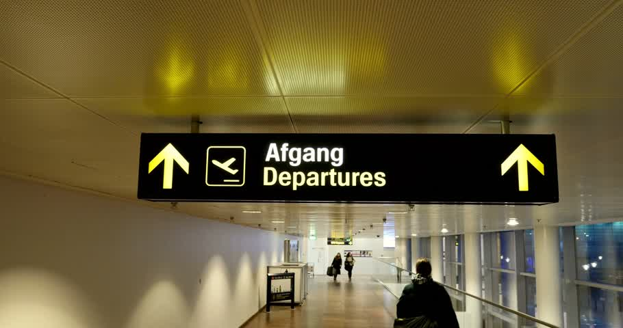pas : Departure sign in airport corridor
