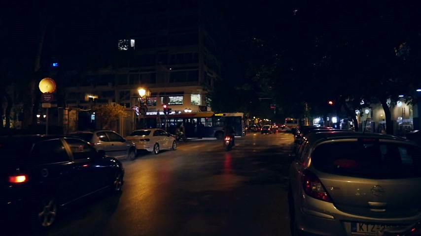 ночная жизнь : THESALLONIKI GREECE  CIRCA 2015:  Tsimiski Street at night in slow motion. It is a major avenue in Thessaloniki the secondlargest city Greece.