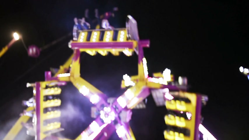 admirado : STRASBOURG, FRANCE - CIRCA 2015: Ride in slow motion with large carousel in amusement theme park during a summer night admired by family Stock Footage