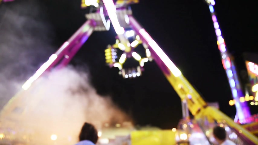 admirado : STRASBOURG, FRANCE - CIRCA 2015: Ride  with large carousel in amusement theme park during a summer night admired by family Stock Footage