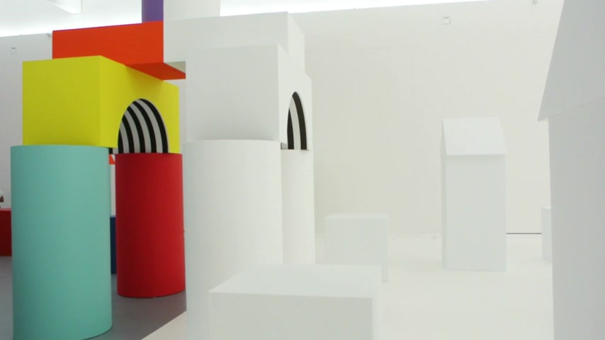 admirado : STRASBOURG, FRANCE - CIRCA 2015: Visitors walks through Strasbourg Museum of Modern Art - Daniel Buren temporary exhibition with white and colorful gigantic toys. Like Childs Play modern art work are admired all around the world