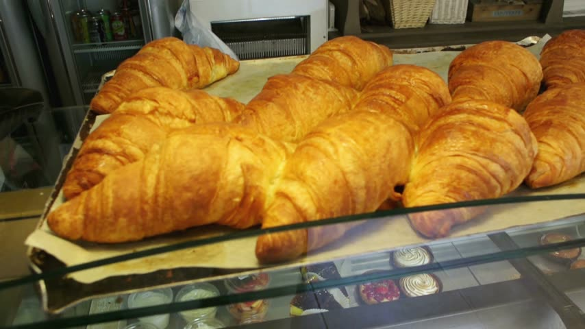 kruvasan : French croissant bread in authentic French cafe Stok Video