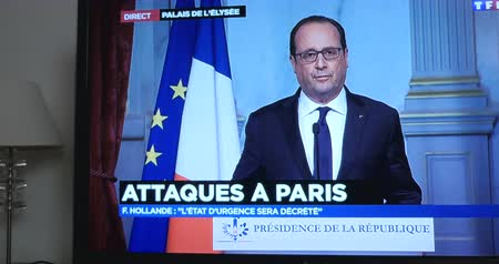 je suis charlie : PARIS, FRANCE - NOV 13, 2013: Francois Hollande at French Television address to the Nation on the Terrorist Attacks. At least 120 were killed across Paris, with explosions outside the national stadium
