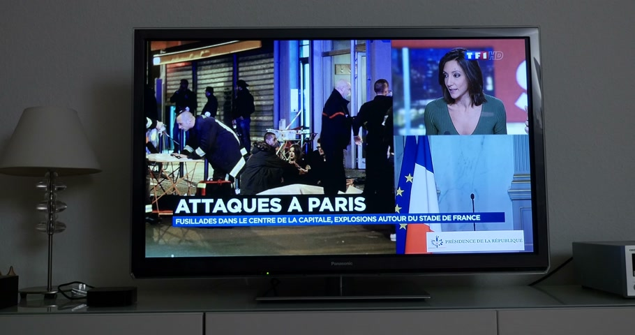 je suis charlie : PARIS, FRANCE - NOV 13 2013: French Television reporting live as rescuers working on the scene of the attack. At least 40 people were killed across Paris, with explosions outside the national stadium