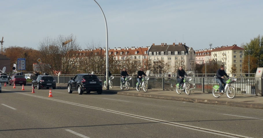 je suis charlie : STRASBOURG, FRANCE - NOV 14 2015: French Police checking vehicles on the Bridge of Europe between Strasbourg and Kehl Germany, after attacks in Paris  - cyclists passing the bridge