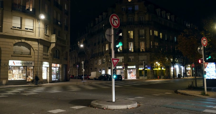 je suis charlie : STRASBOURG, FRANCE - 14 NOV 2015: Police officers in white police vehicle in the center of Strasbourg surveilling the city after the  November 13 attacks in Paris that killed at least 128 people Stock Footage