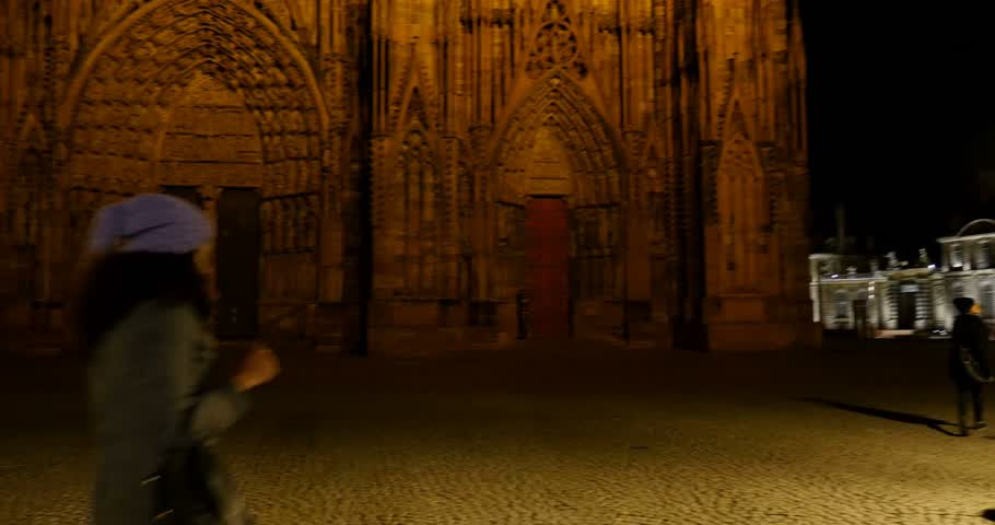 mobilization : STRASBOURG, FRANCE - 14 NOV, 2015: Almost empty place in front of the Strasbourg Cathedral of Strasbourg after attacks in Paris on 13 November with a few tourists