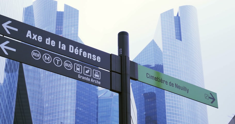 arche : PARIS, FRANCE - CIRCA 2015: La Defense Paris France business district with direction sign to Bus, Train and Cemetery
