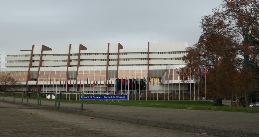 je suis charlie : STRASBOURG, FRANCE - 14 Nov 2015: Wide view of all European Union Flags flying at half-mast in front of the Council of Europe following an terrorist attack in Paris
