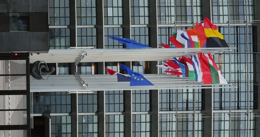 je suis charlie : STRASBOURG, FRANCE - 14 Nov 2015: European Union Flags and France flag flies at half-mast in front of the European Parliament building following an terrorist attack in Paris