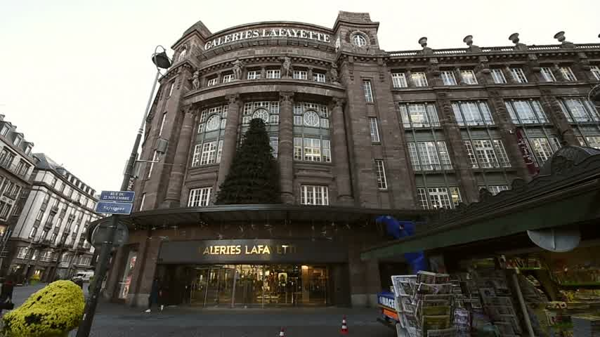 mobilization : STRASBOURG, FRANCE - 16 NOV, 2015: Almost empty Luxury Galeries Lafayette street and press kiosk display headlining the terrorist attacks in Paris on 13 November Stock Footage