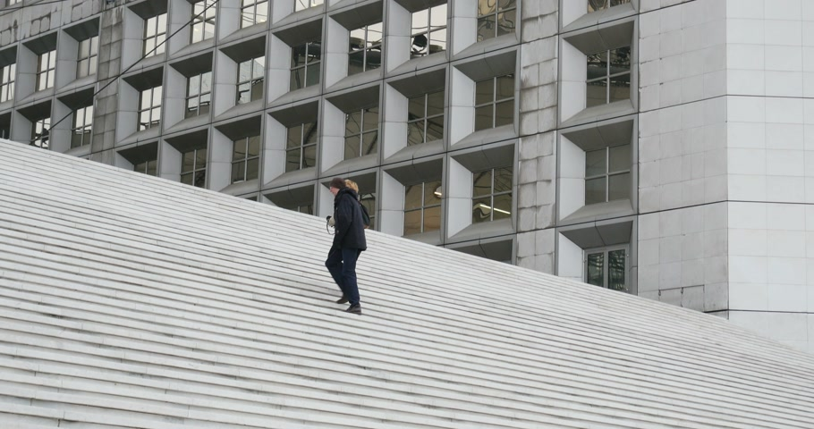 arche : PARIS, FRANCE - CIRCA 2015: Couple climbing and admiring stairs of La Grande Arche de la Defense the monument and building in the business district of La Defense and in the commune of Puteaux, to the west of Paris, France. It is usually known as the Arche