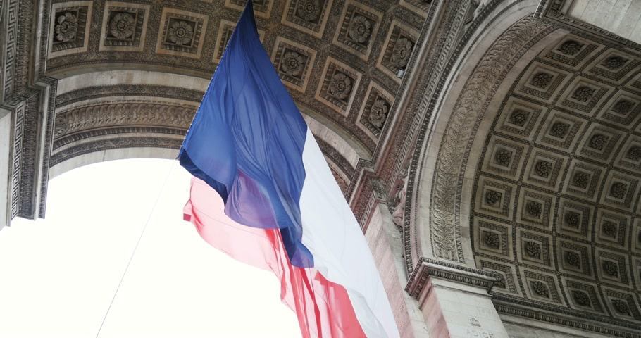 siker : Slow motion of French Flag waving at Arc de Triomphe - Triumphal Arch, the symbol of Paris in Place Charles de Gaule - the symbol of French people and revolution
