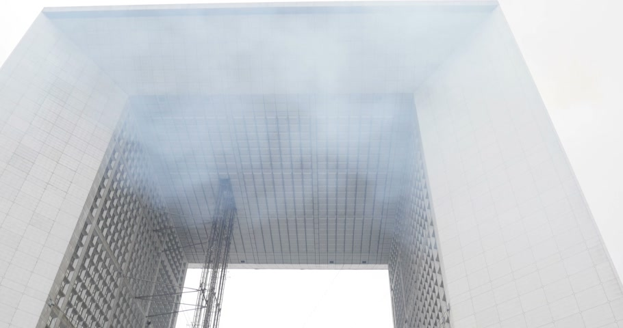 arche : La Defense, Paris at Christmas - smoke in front of the monument from the nearby Christmas chalet selling food