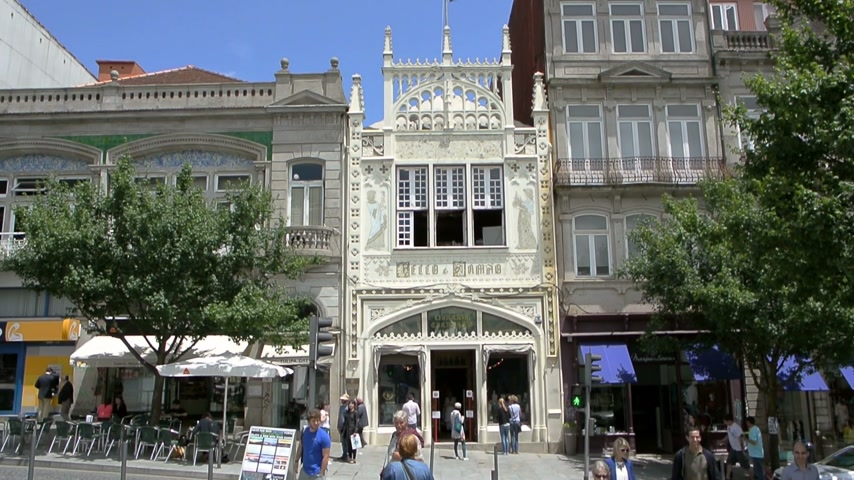 bookshop : PORTO, PORTUGAL - Circa 2016: People admiring the faade of the world famous bookstore Livraria Lello, established in 1919. It is one of the oldest bookstores in Portugal and one of the most beautiful in the world