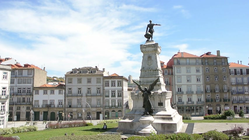 infante : PORTO, PORTUGAL - CIRCA 2015: Place Praca do Infante Dom Henrique the statue. Infante Henrique of Portugal, Duke of Viseu 4 March 1394  13 November 1460, better known as Henry the Navigator was an important figure in 15th-century Portuguese politics and i Stock Footage