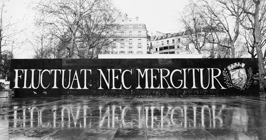 alegorie : PARIS, FRANCE - CIRCA 2016: Chinese woman passing in front of the Fluctuat Nec Mergitur Tossed but not sunk motto of Paris in Place de la Republique Republic square drawn in support of the victims after terrorist attack on November 13 2015 in Paris, Fra