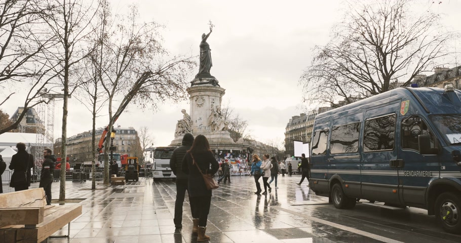 mass shooting : PARIS, FRANCE - CIRCA 2016: Timelapse of people gather to place candles at Place de la Republique Republic square in support of the victims after terrorist attack on November 13 2015 in Paris, France. Stock Footage