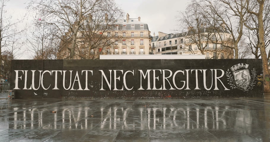 mass shooting : PARIS, FRANCE - CIRCA 2016: Fluctuat Nec Mergitur Tossed but not sunk motto of Paris in Place de la Republique Republic square drawn in support of the victims after terrorist attack on November 13 2015 in Paris, France.