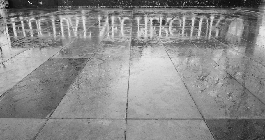 alegorie : Black and white asphalt reflection of Fluctuat Nec Mergitur Tossed but not sunk motto of Paris in Place de la Republique Republic square drawn in support of the victims after terrorist attack on November 13 2015 in Paris, France. Dostupné videozáznamy