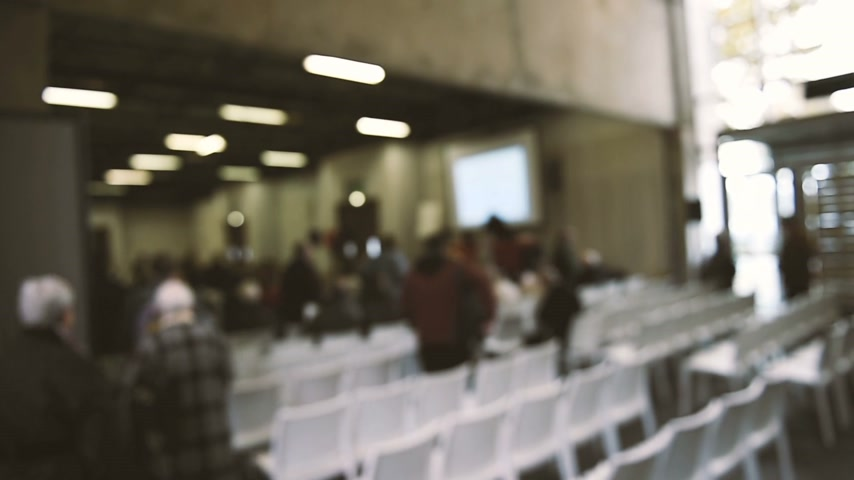 conference centre : Defocused view of people attending a public seminar, coaching seminar, public lesson, training event