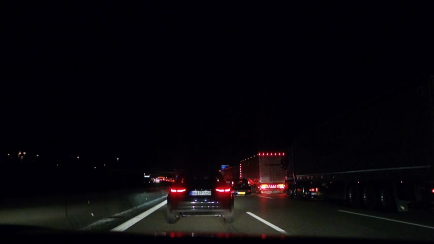 kierowca : GERMANY - CIRCA 2016: Driver point of view of car Driving at night on repairing portion of German Autobahn with traffic jam