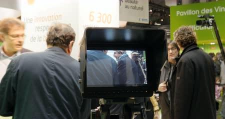 phonogram : PARIS, FRANCE - FEB 2016: Camera on tripod preparing to go Live On Air at the Paris International Agricultural Show - Salon International de Agriculture direct broadcast Stock Footage