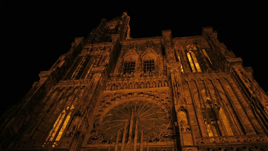 alsatian : Strasbourg Notre-Dame Cathedral panning from Cathedral building to the Alsatian house