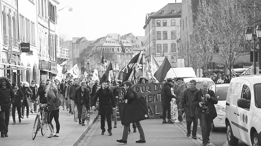 nationwide protest : STRASBOURG, FRANCE - 9 MAR 2016: Crowd marching with Communist flags as thousands of people demonstrate as part of nationwide day of protest against proposed labor reforms by Socialist Government