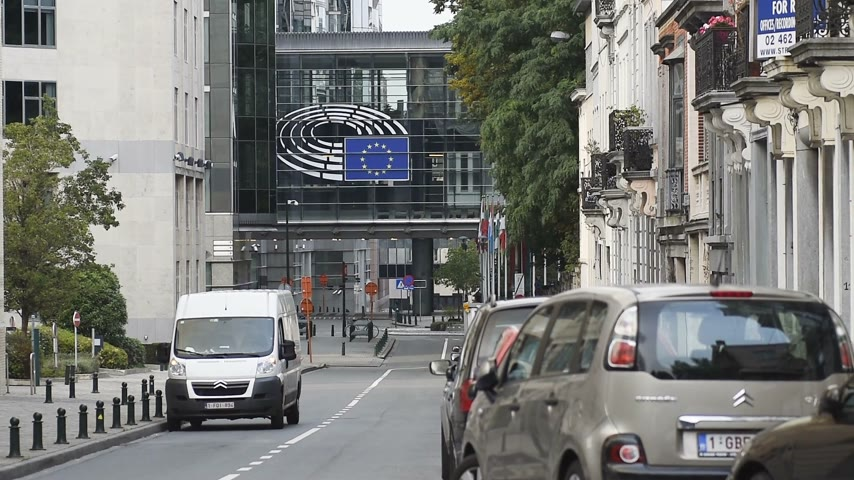 belga : BRUSSELS, BELGIUM - CIRCA 2016: Timelapse fast motion in front of the European Parliament in  Brussels (Bruxelles), Belgium on a clear peaceful day. The European Parliament (EP) is the directly elected parliamentary institution of the European Union (EU).