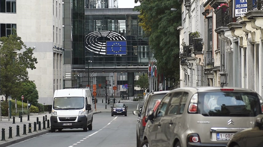 belga : BRUSSELS, BELGIUM - CIRCA 2016: Empty secured zone with one car in front of the European Parliament in  Brussels (Bruxelles), Belgium on a clear peaceful day. The European Parliament (EP) is the directly elected parliamentary institution of the European U