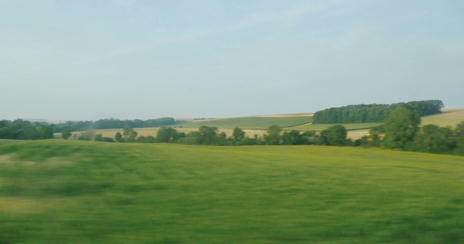 pociąg : View from the high speed train TGV at beautiful French landscapes with hills and forest Wideo