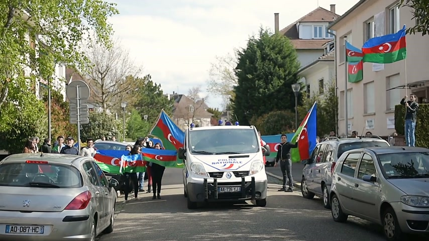 unrest : STRASBOURG, FRANCE - APR 8, 2016: Armenian diaspora singing trade song at protest outside Azerbaijan Embassy against the 2016 clashes in Nagorno-Karabakh, the region disputed by Armenia and Azerbaijan